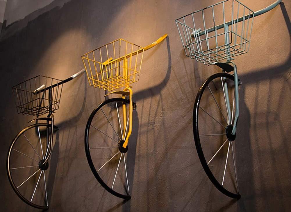 Vélo en fer forgé encastré dans le mur insolite | Idées cadeaux et décoration insolites originales